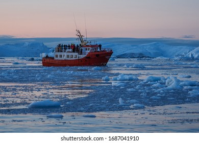 Ship sailing through the icy waters of  Greenland.