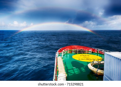 Ship sailing through rainbow