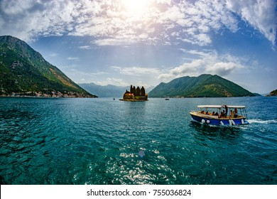 The ship sails to Island of Saint George is one of the two islets off the coast of Perast in Bay of Kotor, Montenegro