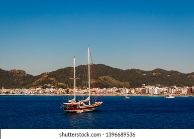 the ship sails on the sea in the port of Marmaris , blue clear sky