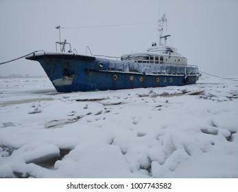 the ship sails through the ice