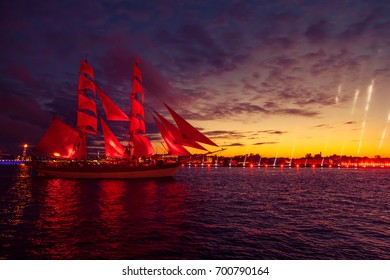 Ship with scarlet sails in the river Neva. Wonderful sunrise in St.-Petersburg.