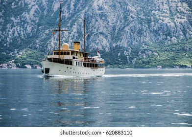 Ship in the sea against the background of mountains