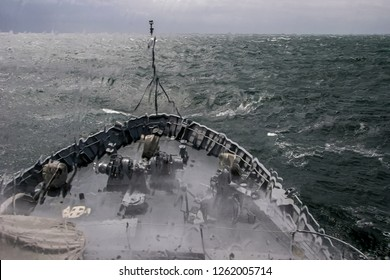 Ship in sea storm. Storm at Baltic sea. Warship training in the Baltic Sea during a storm. Military ship in Baltic sea, Latvia. Military ship during a storm. view from ships the bow.