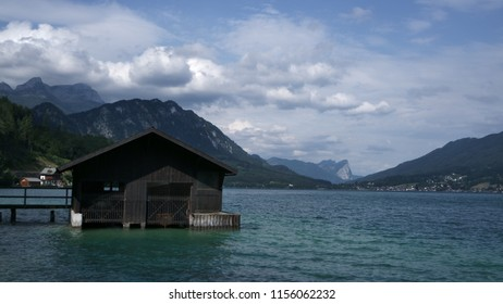 Ship shed on the lake sunlit in the morning. Quiet day at the attersee lake.