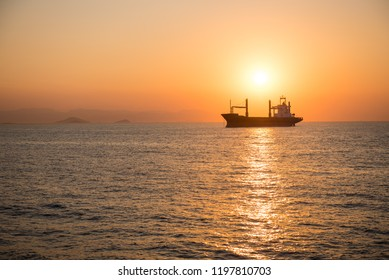 Ship silhouette against sunset sky. Beautiful sea landscape.