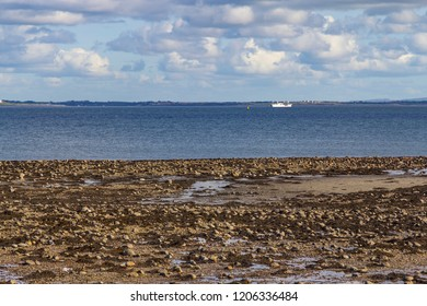 Ship in Silverstrand beach with ocean and rocks, Galway, Ireland