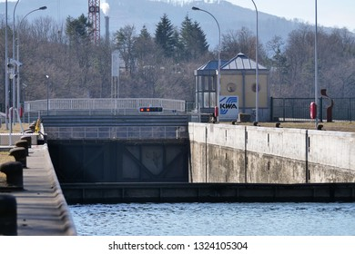 ship sluice at river Rhein in Augst with oclosed lock gate and low level water, ready to enter in. CH Switzerland. 26th Febr.2019