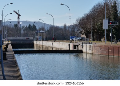 ship sluice at river Rhein in Augst with closed lock gate filling up with water, ready to enter in. CH Switzerland. 26th Febr.2019