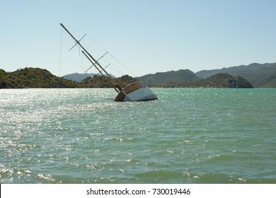 A ship sunk in a bay in shallow waters in Kekova, Turkey.
