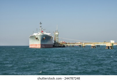 ship tanker lng gas in port blue sky