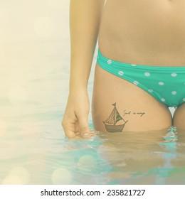 Ship tattoo on a hip of traveler (