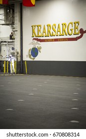 Ship Tour USS Kearsarge (LHD 3) Wasp-class amphibious assault ship: KEARSARGE and Semper Fidelis painted on the wall in the hangar bay. Fleet Week NEW YORK MAY 25 2017.