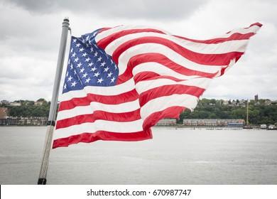 Ship Tour USS Kearsarge (LHD 3) Wasp-class amphibious assault ship: American Flag flies from the bow of the USS Kearsarge (LHD 3). Fleet Week NEW YORK MAY 25 2017.