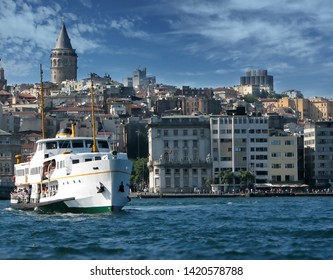 Ship transorting is very common way between europe and asia, istanbul. Galata Tower under the blue sky.
