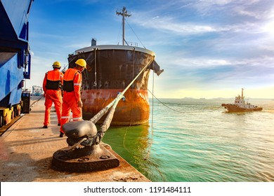 ship vessel is on leaving departure from the port terminal after completion of loading/discharging operation by gang of mooring attending at last party, tug boat standing by to safety assist towage