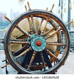 ship wheel at a rainy concert on a boat