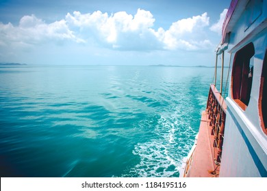 Ship window with a relaxing seascape and blue sky view.Blue sea boat sailing with open bow porthole in summer vacations.tropical island in Thailand