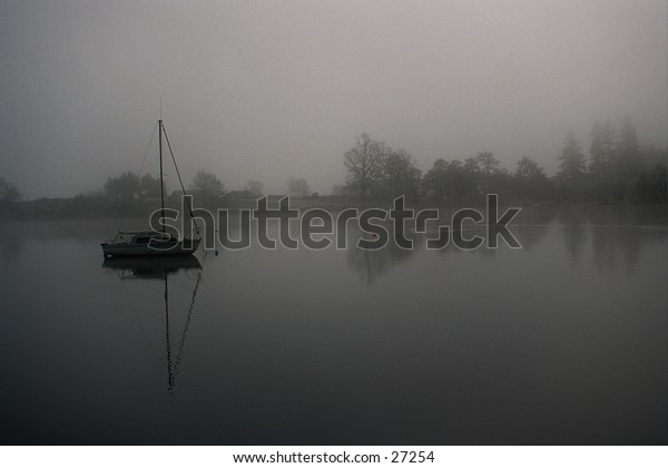 Ship wist mast in misty Loch Ness in Scotland