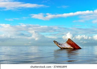 Ship wreck rusty landscape sinking into the sea Trinidad and Tobago