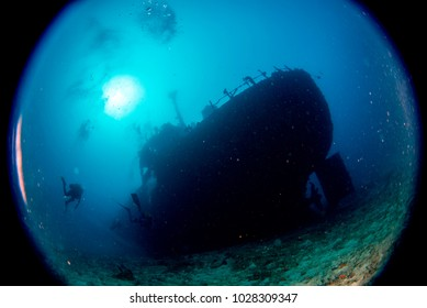 Ship Wreck silhouette underwater while diving