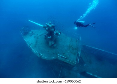 ship wreck in tropical sea ,cannon tower of a sunken ship with scuba diver,H.T.M.S. Prab Wreck Dive, Koh Ngam Noi Island , Chumphon Province Thailand
