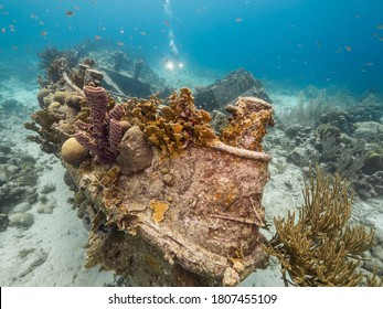 """Ship wreck """"Tugboat Saba"""" in  shallow water of coral reef in Caribbean sea / Curacao with diver in background"""