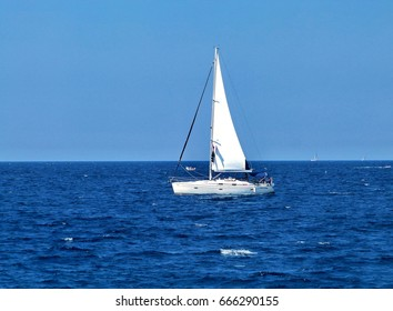 Ship yacht  with white sails in the open sea