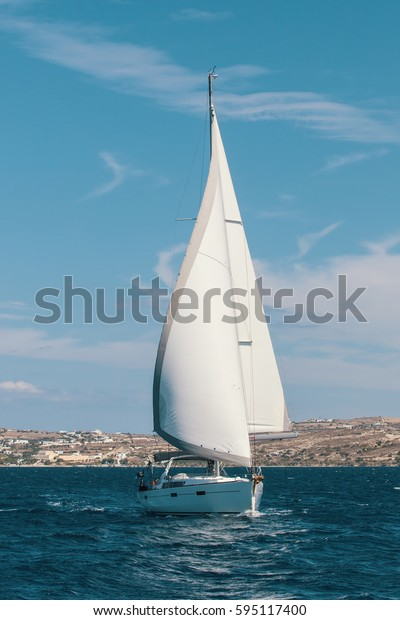 Ship yachts with white sails in the Sea. Sailing. Luxury boats.