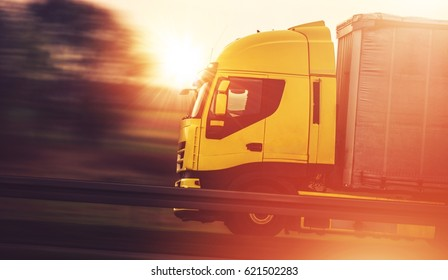 Shipment Transport by Truck. Commercial Trucking Spedition. Speeding Euro Semi Truck on the Highway.
