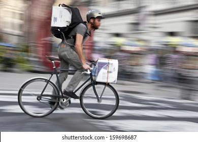 Shipping with bicycle in the city, intentional motion blur