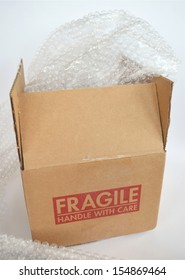 Shipping Box with Bubble Wrap on a White Background