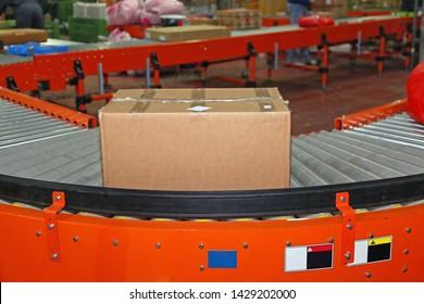 Shipping Box at Conveyor in Distribution Warehouse