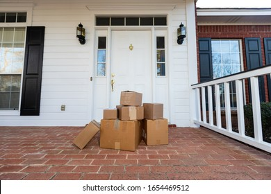 Shipping boxes on front porch of home