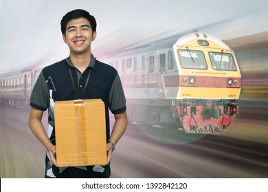 Shipping company workers carrying box on Train background, Asian delivery man carrying boxes on Train background