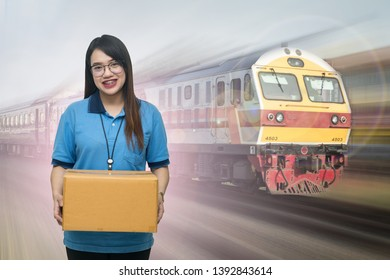Shipping company workers carrying box on Train background, Asian delivery girl carrying boxes on Train background