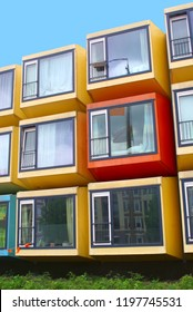 Shipping container homes, stacked in colorful flat building