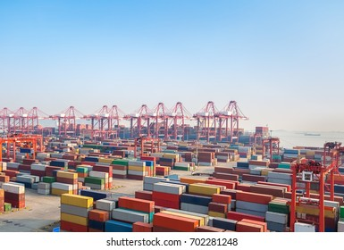 shipping container terminal at dusk,  modern harbor and global trade background