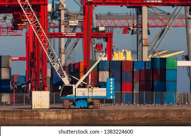 Shipping containers and cranes at the Lisbon Port in Portugal,