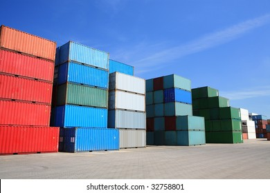 shipping containers - many cargo freight containers stacked in harbor