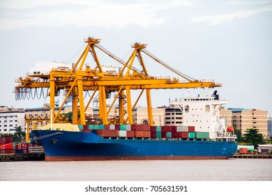 Shipping industrial trade port. Crane bridge and import export container at shipping port harbor. Logistics industrial and transportation business background.