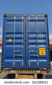 Shipping metal container on heavy truck.