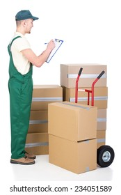 Shipping service. Delivery man with card boxes and hand truck.
