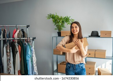 Shipping shopping online, young start up small business owner packing cardboard box at workplace. Female seller prepare parcel boxs of product for deliver to customer. Online selling or e-commerce