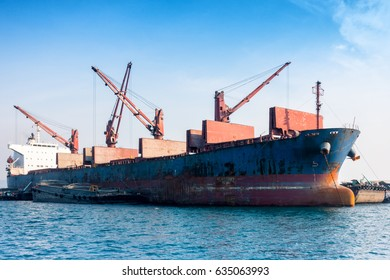 Shipping unloading truck in the ocean. Business transportation.
