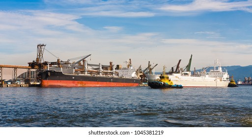Ships being loaded at the Port of Santos, Brazil.