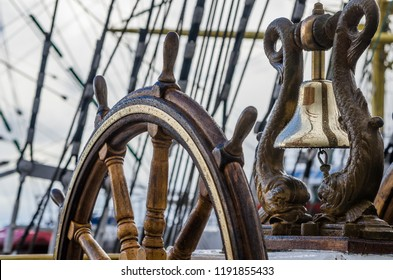 Ship's Bell and wheel the old sailboat, close-up