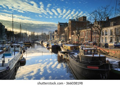 Ships and boats in a canal in Groningen, Noorderhaven, on a cold day in winter.