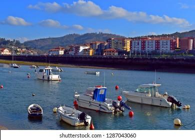 Ships and boats waiting at water HDR