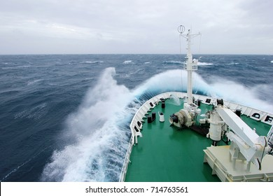 Ship's Bow diving into a big splashing wave, antarctic ocean, Antarctica